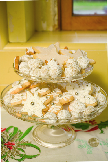 A Tiered Glass Pedestal Topped with Sugared Cookies