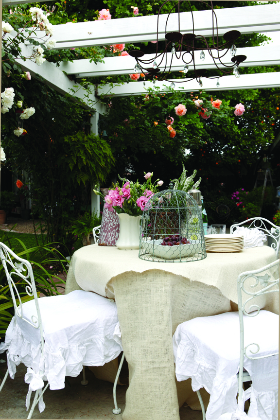 Set a romantic garden table by combining textures and treaures from your garden and home.