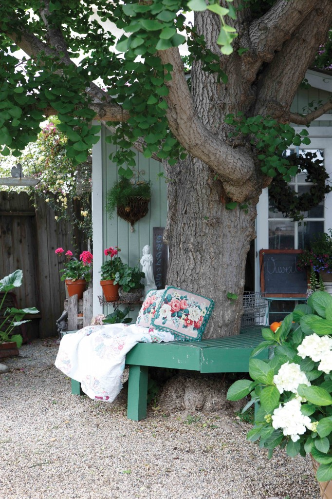 Bring the indoors out: quilts and pillows add a homey feel to this garden bench.