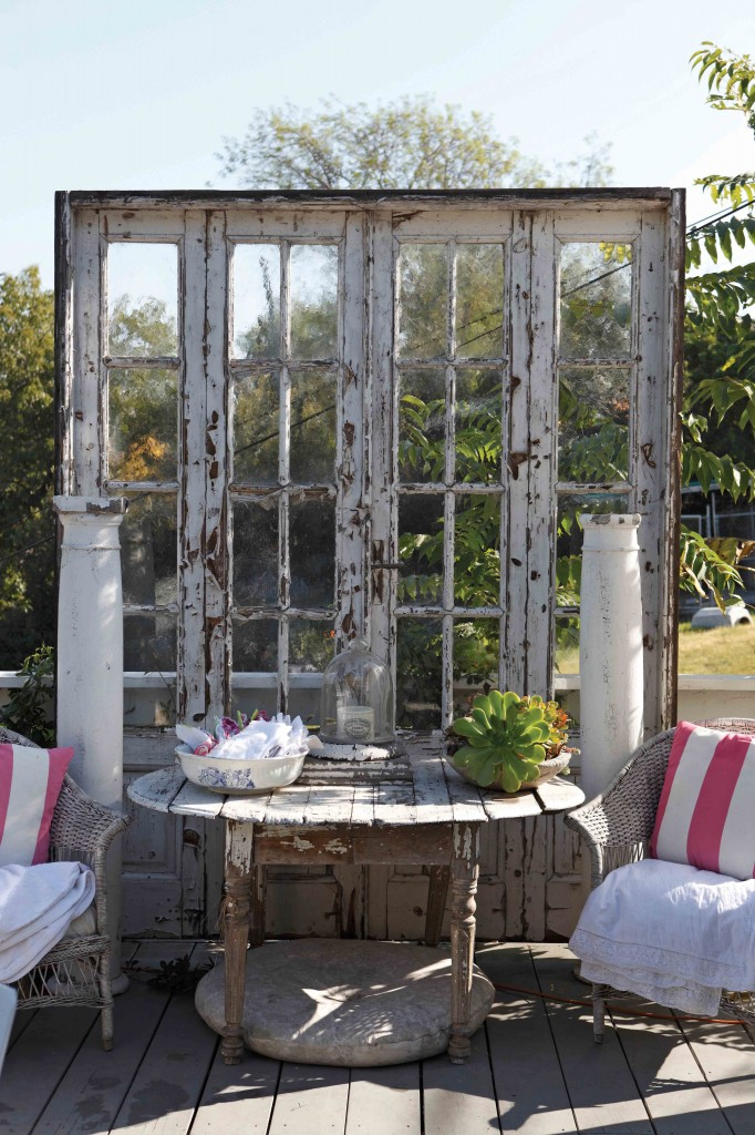 Great flea market finds, such as these antique French doors, can add style and separation to a space.