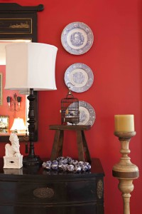 Marion painted the living-room walls red to add warmth, passion and drama to the space.