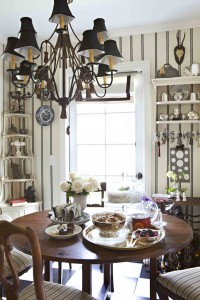 Marino used a black-and-white color palette in her kitchen to complement her collections, which she displays on white shelves.