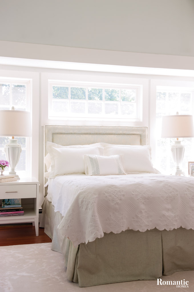 Taking advantage of the lofted ceiling and bright windows, Carey captures the light with white tones.