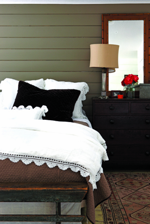 Sage green shiplap and white bedding