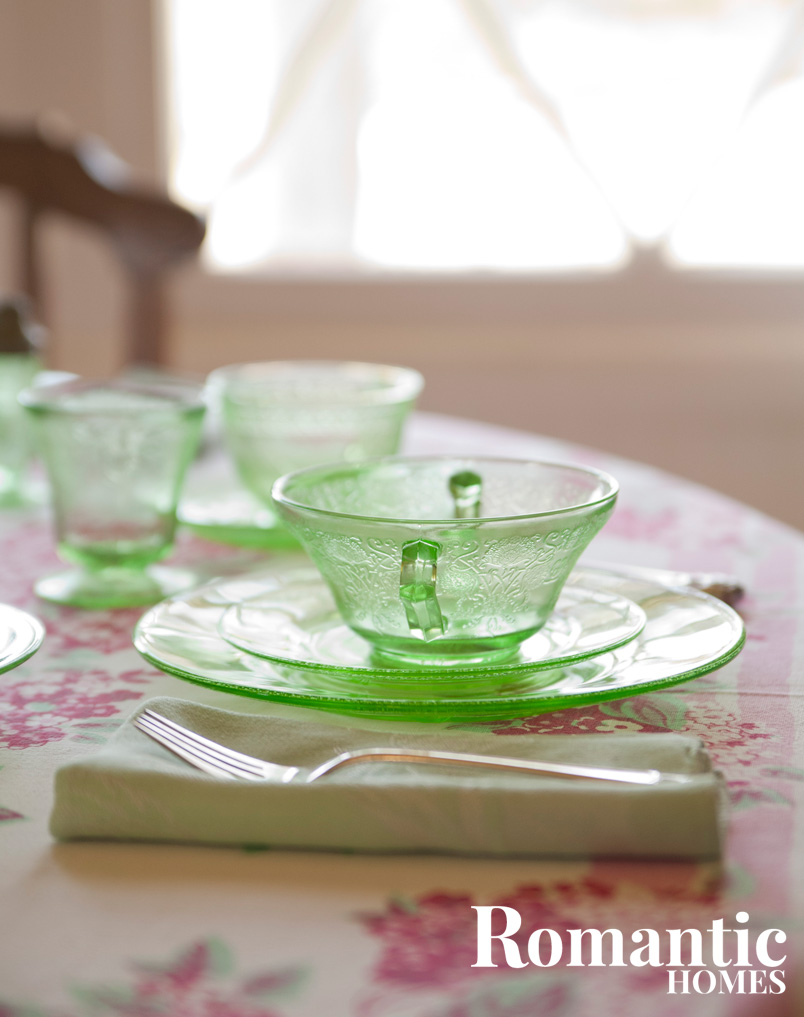 green depression glass teacup and sacer