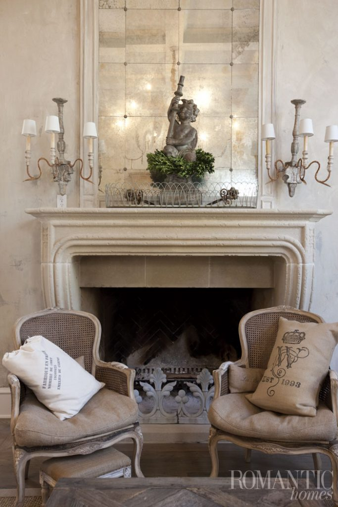 Two Chairs In Front Of Fireplace
