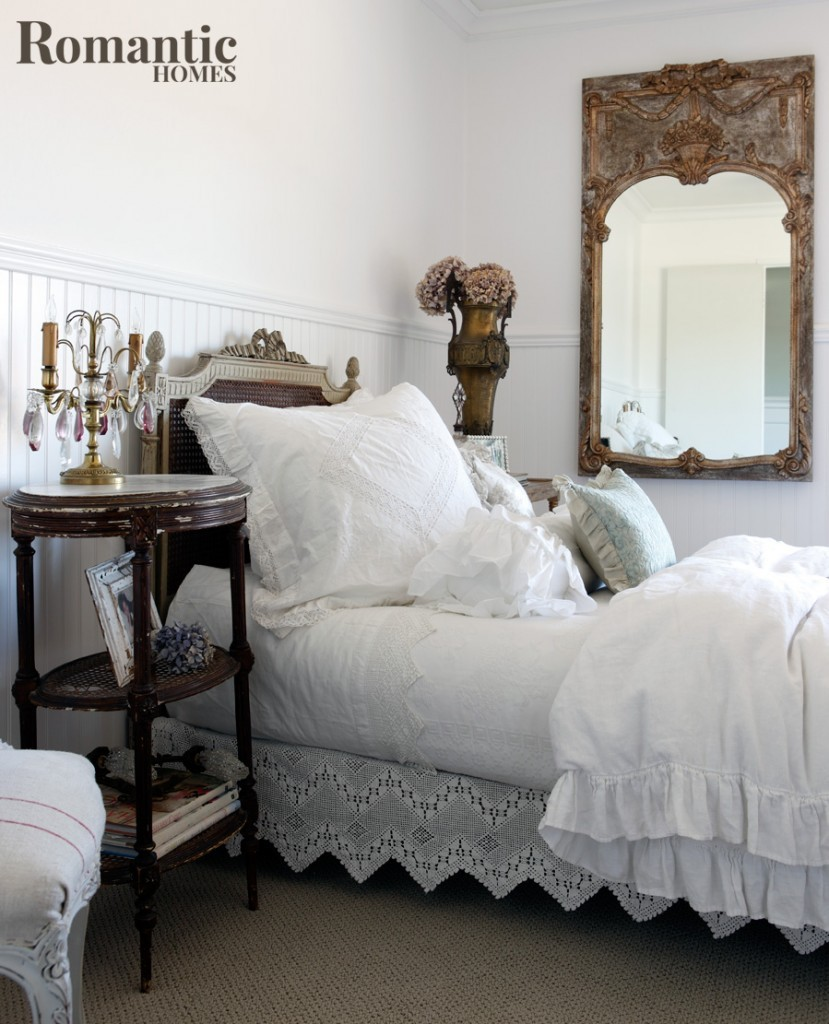 A romantic white bedroom with vintage furnishings