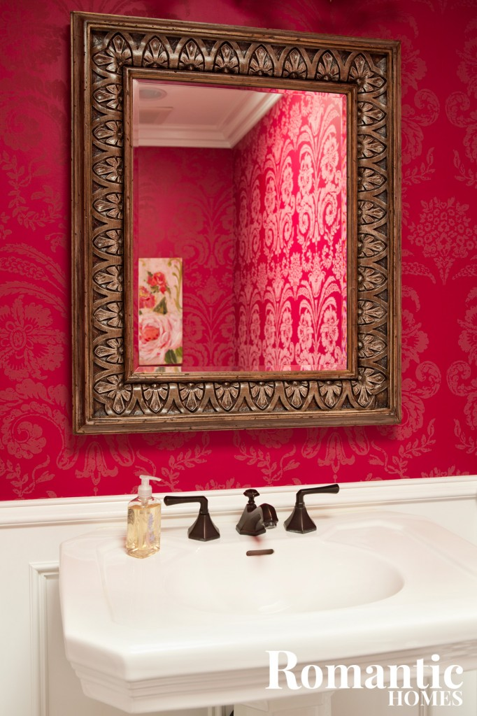 Deep Pink Walls And A White Bathroom Sink
