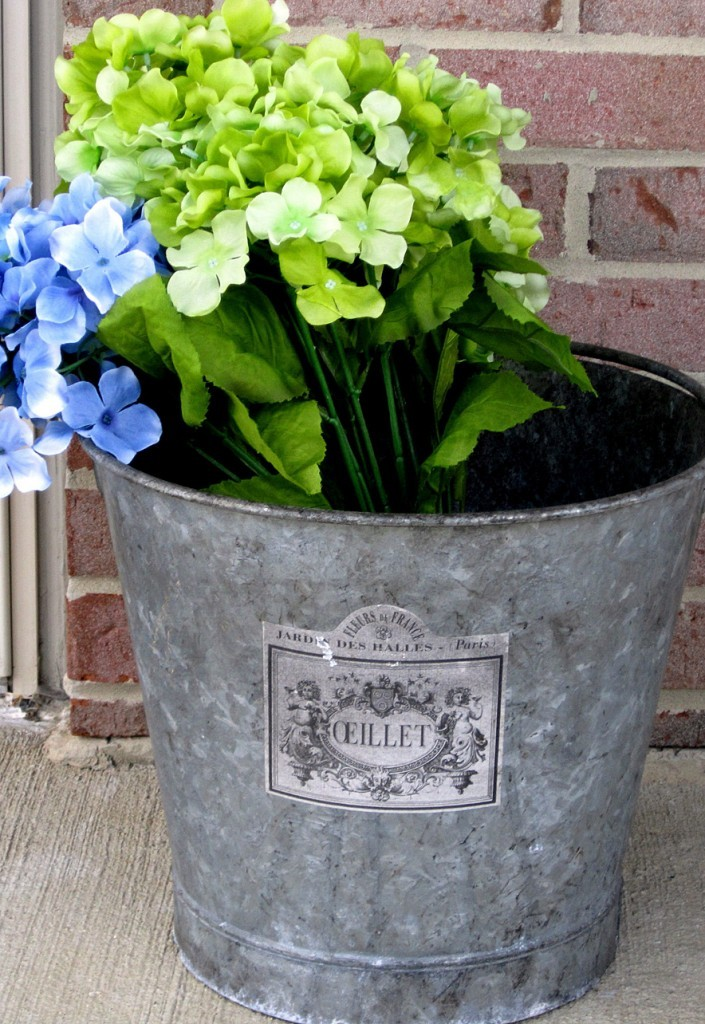 Flowers in an old french galvanized metal flower bucket