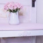 Rose shaped plaster appliques add charm to any table.  Photo credit: www.whitelacecottage.com