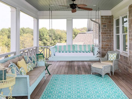 Coastal style patio with turquoise rug