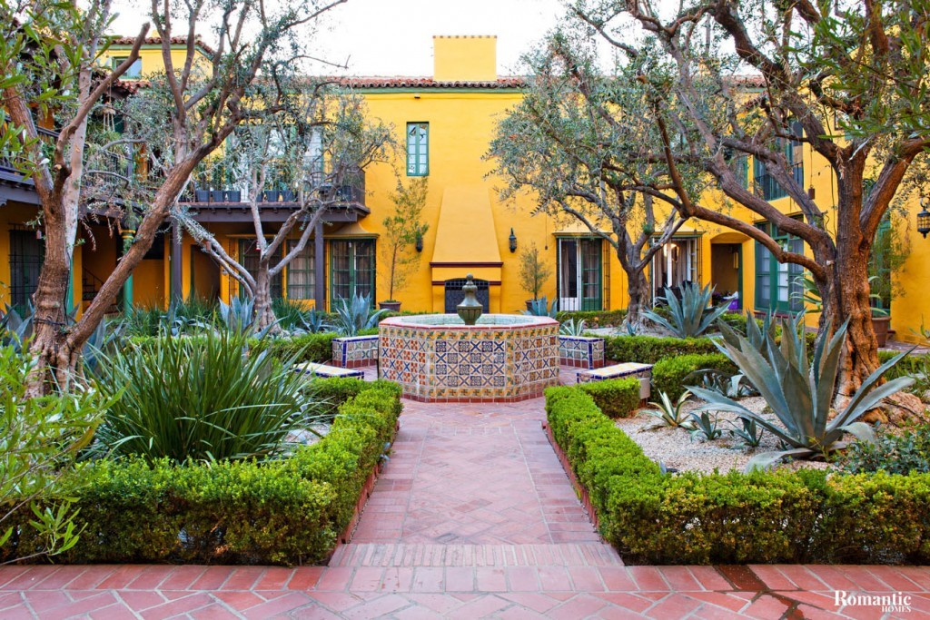 Like other residences designed by Arthur and Nina Zwebell, Jennifer's complex features a beautiful central courtyard with a fountain. She can view the courtyard with its olive trees and succulents through French doors in her living room.