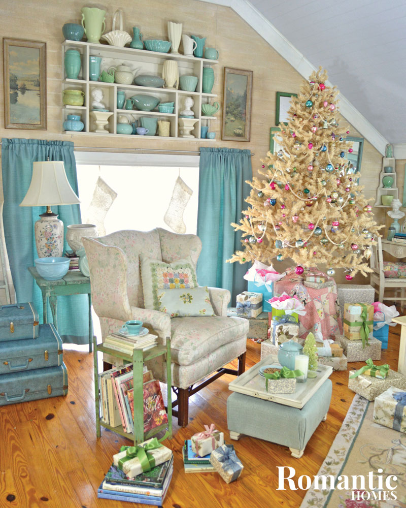 A beautiful attic room is decked out for the holidays in white, aqua and pastels.