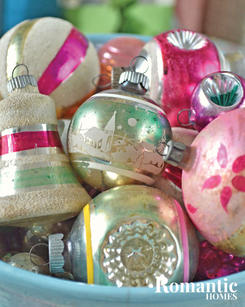 A collection of vintage ornaments in pastel colors.