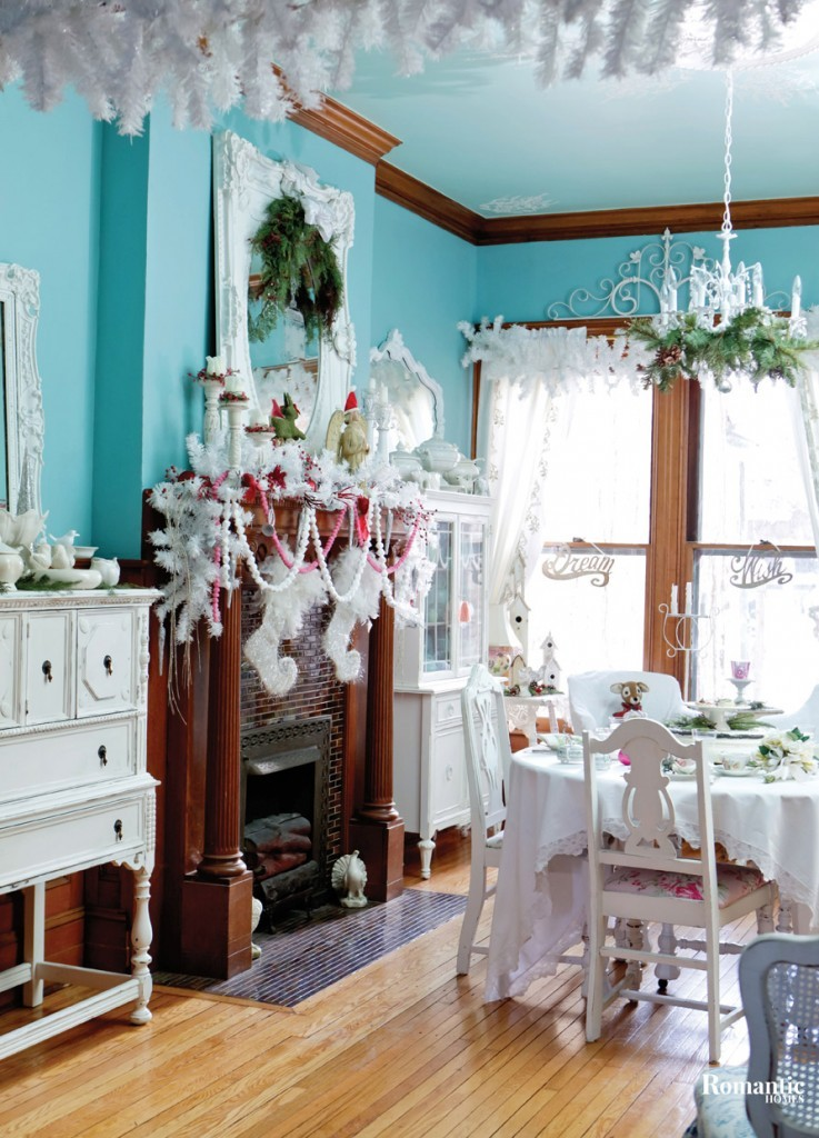 The home's bright aqua walls are complemented by a mix of white furnishings and accessories. At the holidays, Donna turns up the look with white and green garlands, and pink accents.