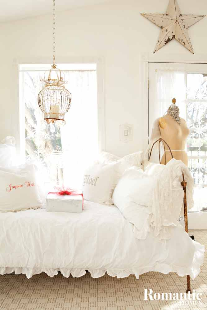 Day bed piled high with pillows and presents.