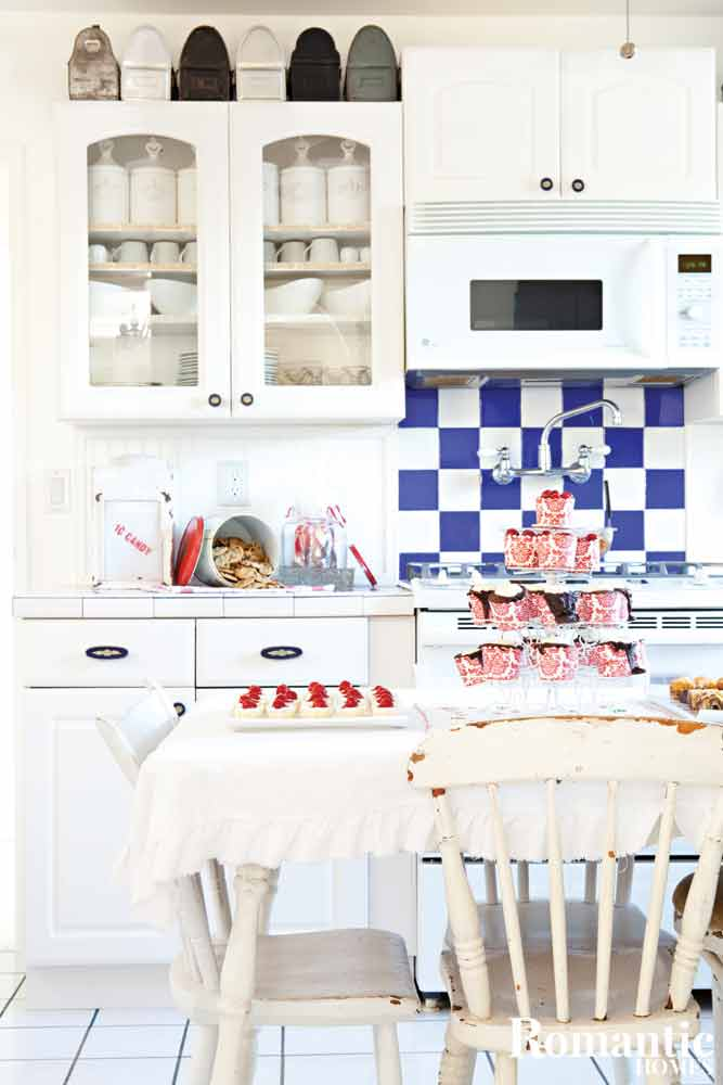Nordic style kitchen with blue and whtie tile backsplash and red Christmas details.