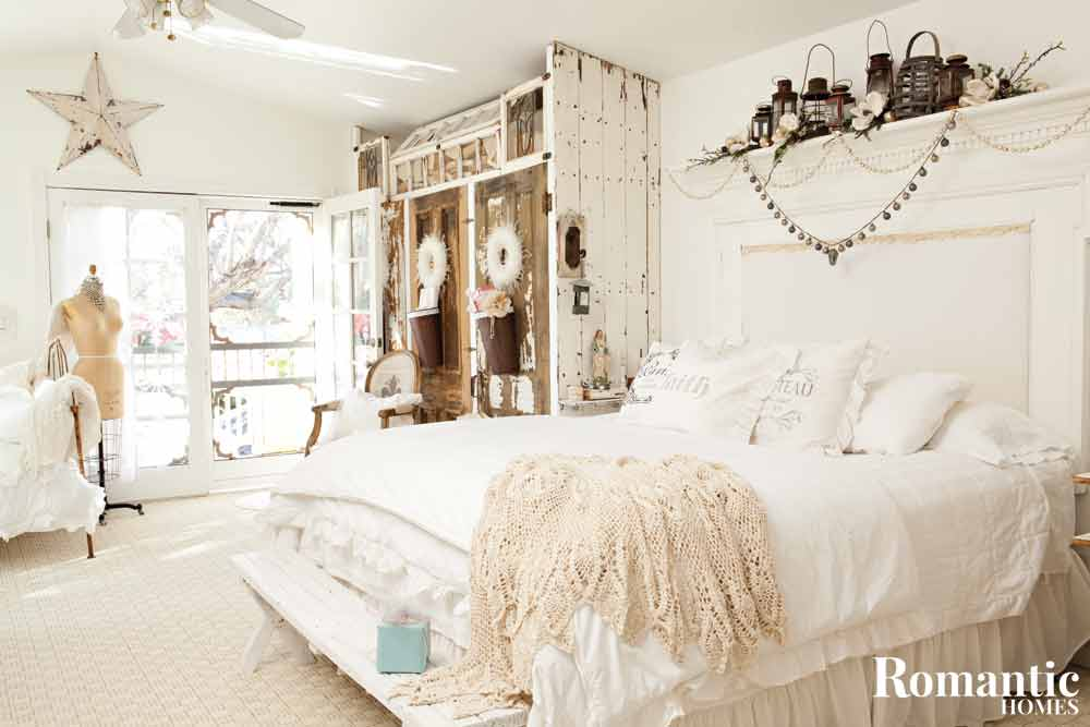A white, Nortic style bedroom with rustic holiday decor.