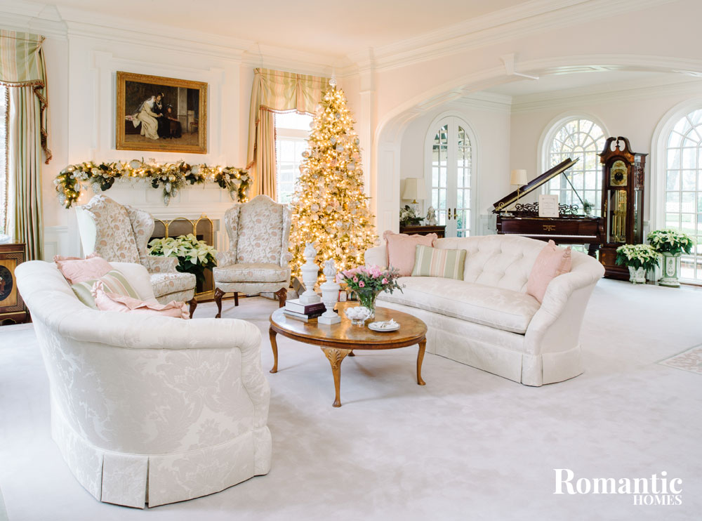 white living room with pink and gold tree