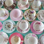 A top down view of a dozen various teacups