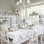 Cottage style dining room with wood chairs and chandlier