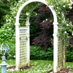 White arbor covered with pink and white roses