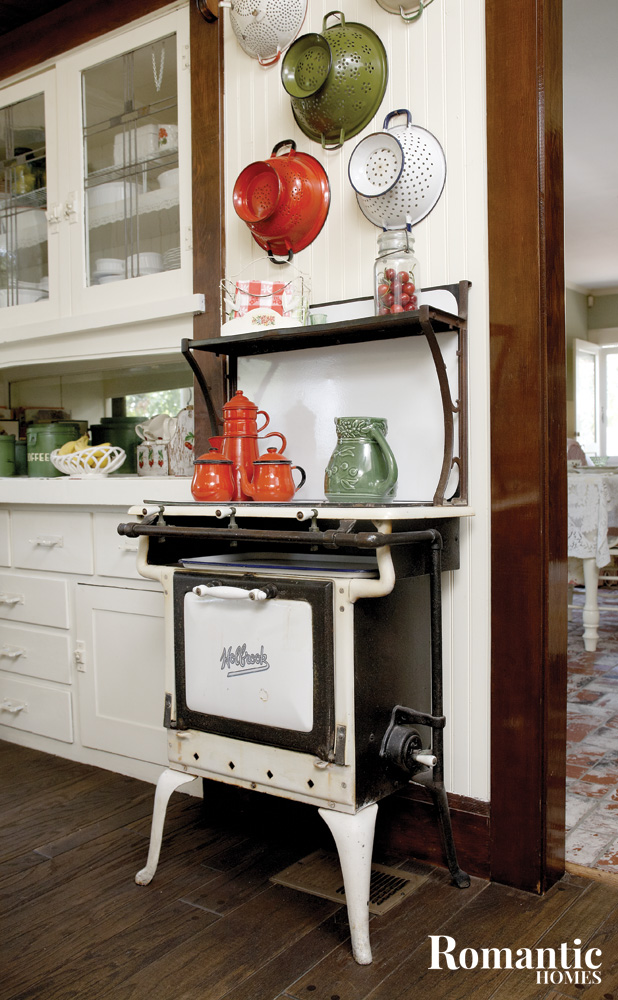 vintage stove displayed with kitchen collectibles