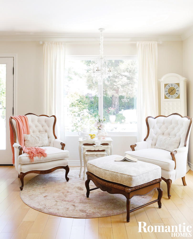 White armchairs and a toile covered ottoman