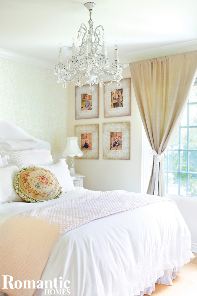 White bedroom with garden view and tapestry pillow