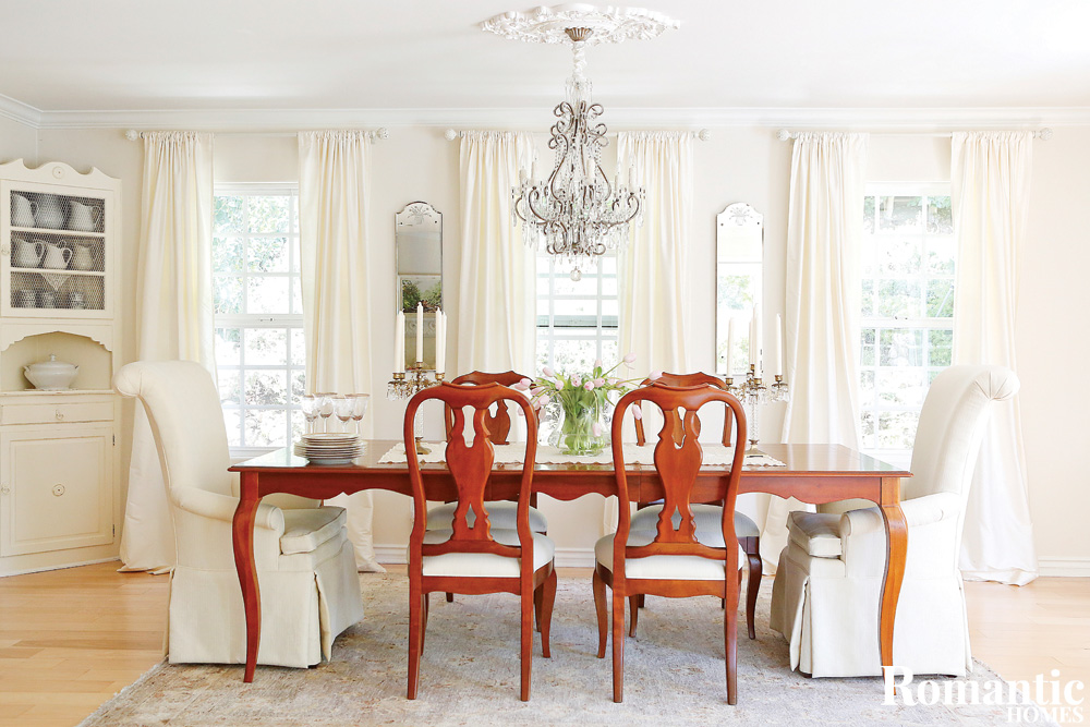 White dining room with full length windows