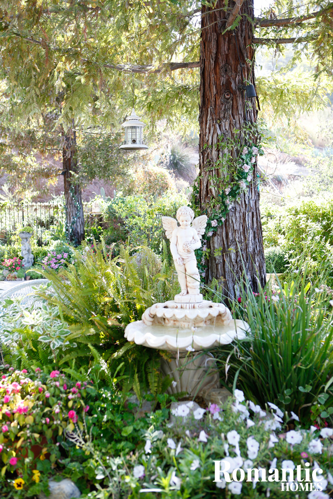 Angle sculpture watching over a tranquil garden