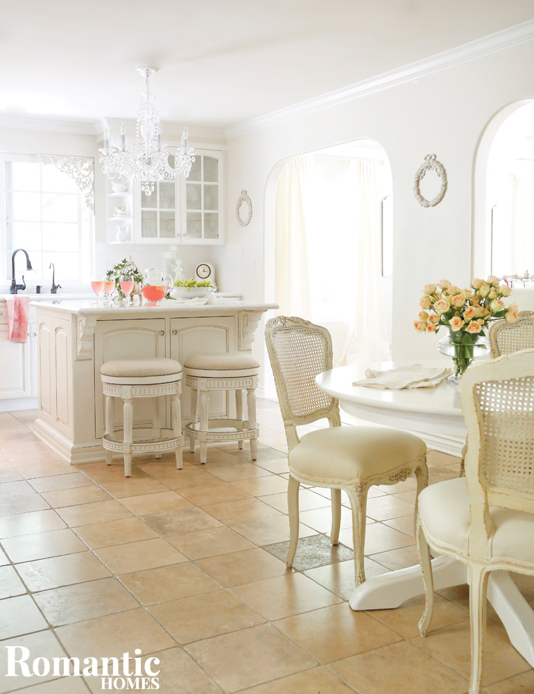 White kitchen with cane back chairs