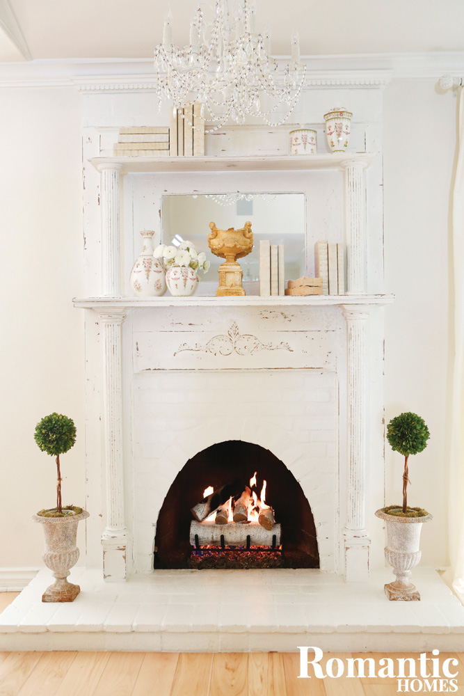 Vintage fireplace mantel in white