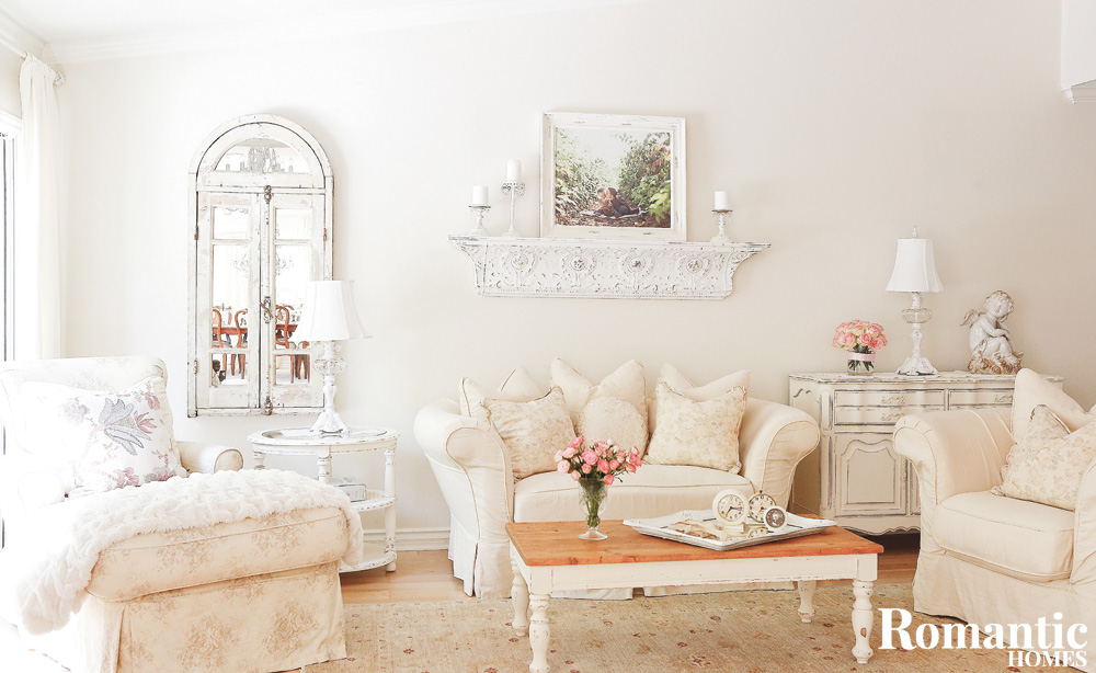 Living room with white sofa and chair and vintage furniture
