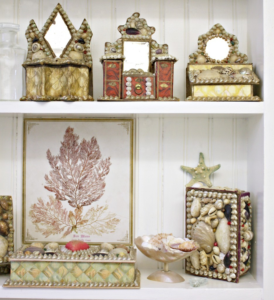 Antique shellwork boxes displayed on a shelf