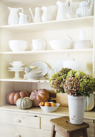 Heirloom pumpkins add color to Courtney Allison's curated collection of servingware