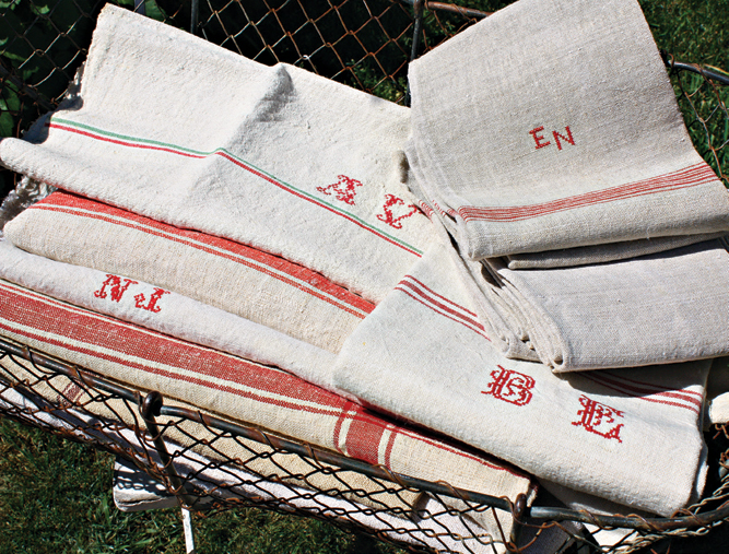 Linens with red-embroidered monograms