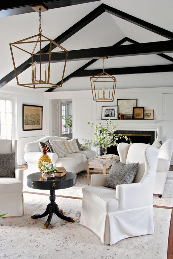 White slipcovers keep formal furniture safe from spills