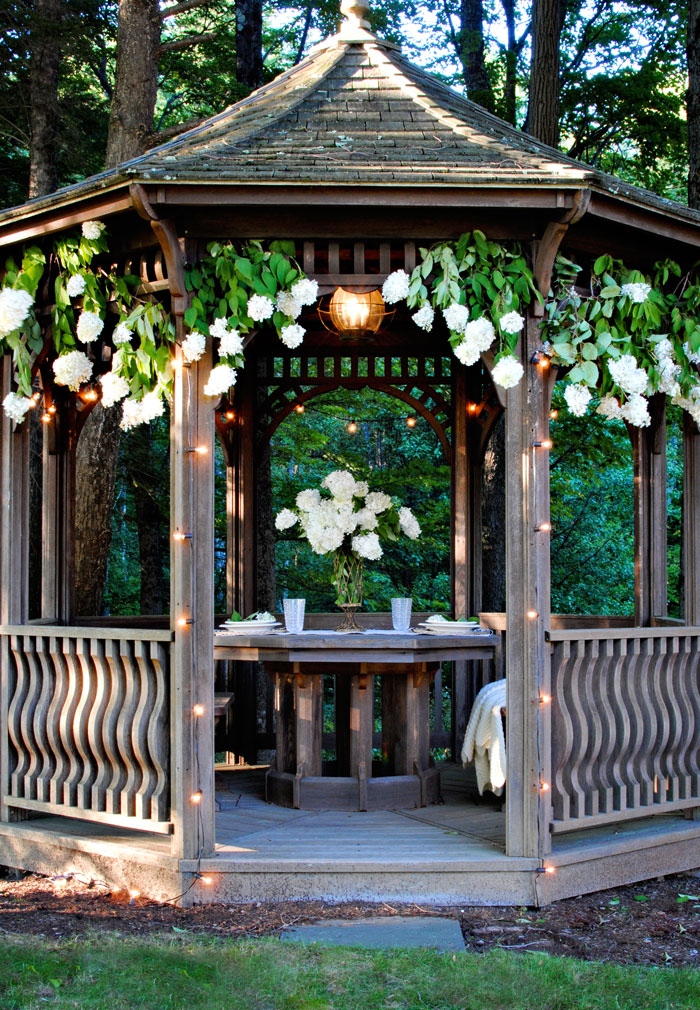 The gazebo at Blue stone Hill is decked in lights and flowers for a romantic ambiance.