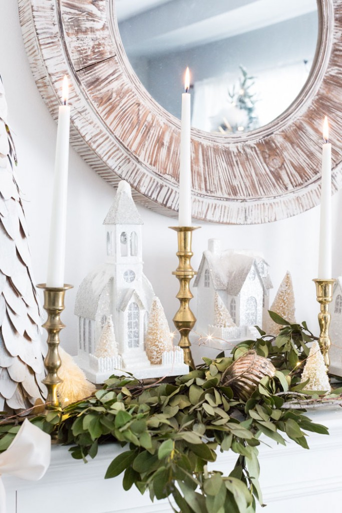 Lucy of Craftberry Brush blog decorates her mantel with dried leaves, brass candlesticks and a glittery Christmas village.