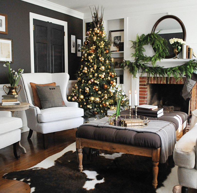 simple dcor and textures enhance an understated and elegant holiday look copper brass and gold metallic finishes as well as green garlands and wreaths - Cozy Christmas Decor