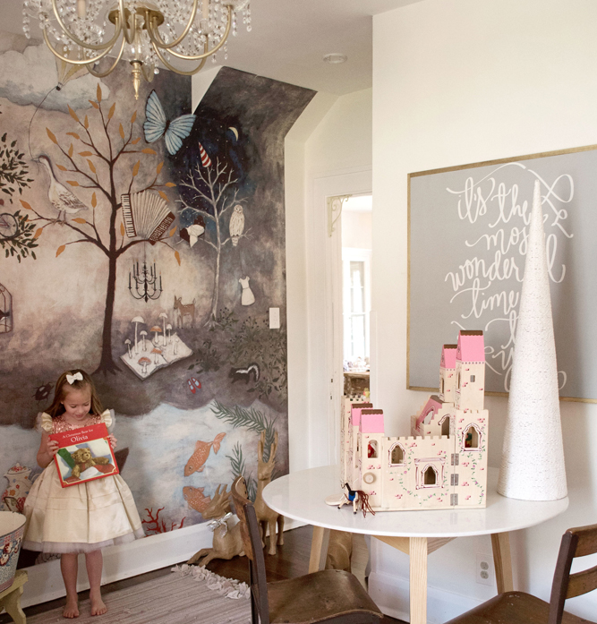 A fairy-tale woodland inspired mural adds whimsy to the playroom.