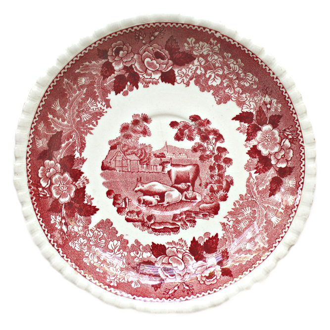 Red transferware plate with cows