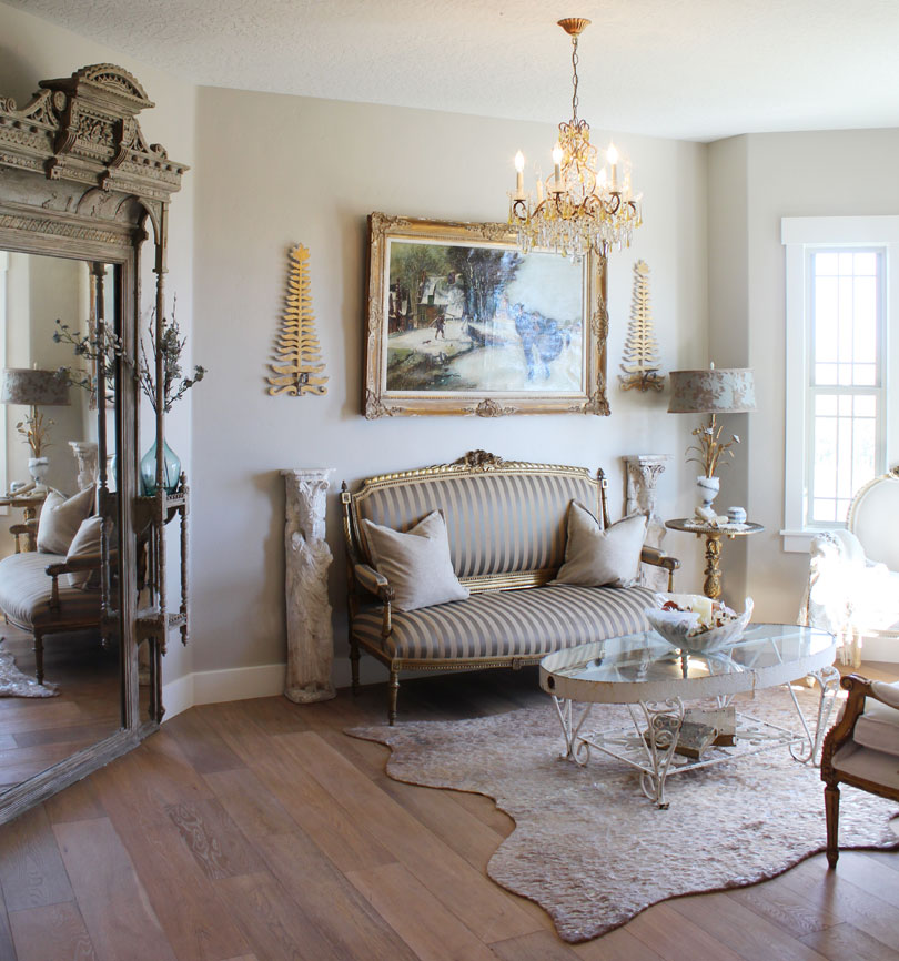 A mix of old and new, Alys' front room combines modern pieces with antiques.