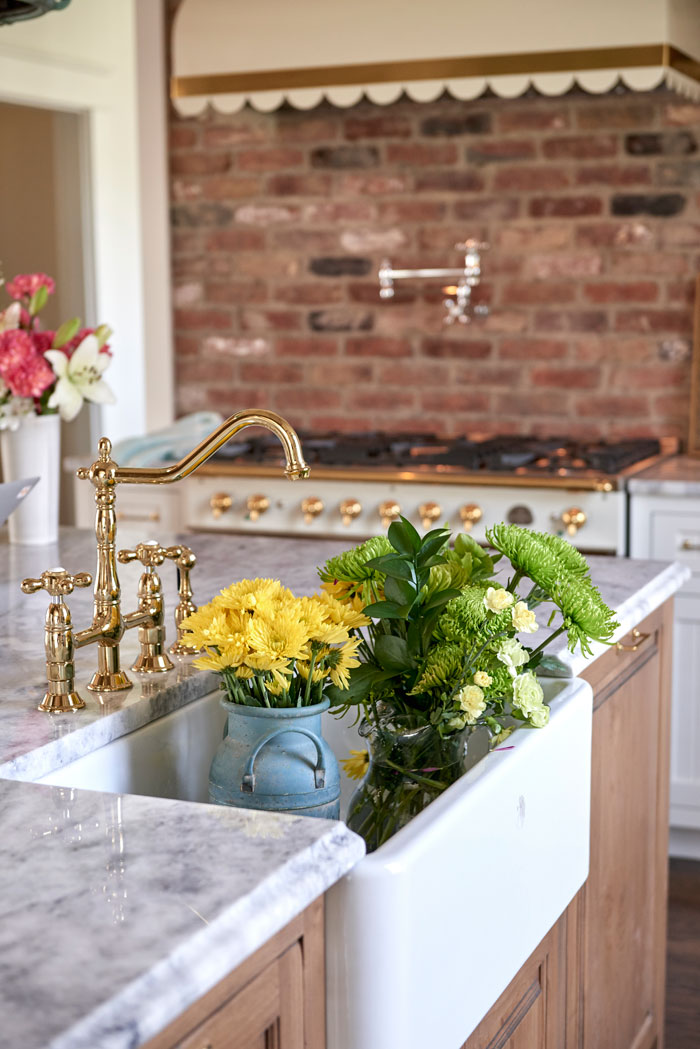 An apron sink adds a country touch to the space.
