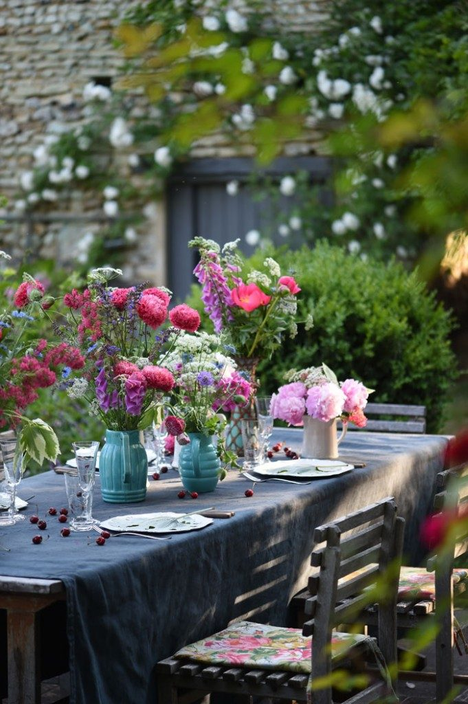Colorful flowers pop against the black linen tablecloth