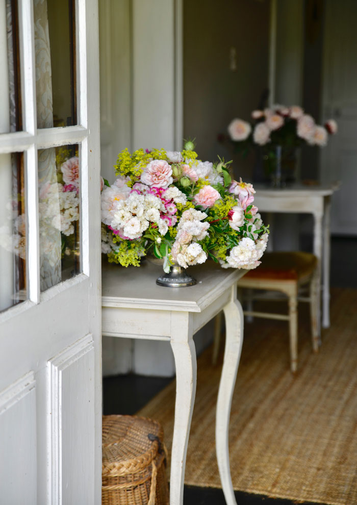 The tables of Sharon Santoni's entryway are full of flowers