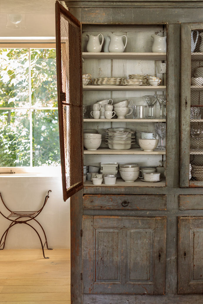 The antique hutch is aged and worn to the perfect finish. Many of the Giannetti's antiques are imported from Europe.