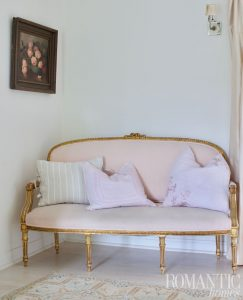 Rachel Ashwell's gold and pink settee