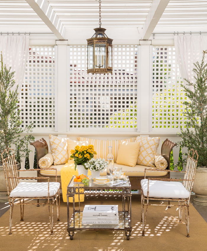 A small, Charleston-style enclosed patio offers a secluded seating area to enjoy the sea breeze.